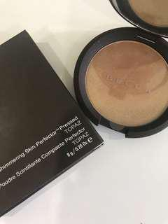 AUTHENTIC Becca highlighter in Topaz