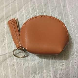 Tan-colored coin purse