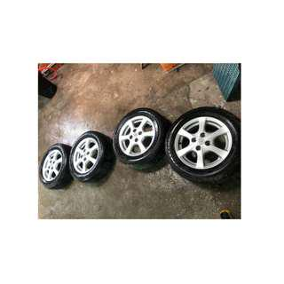 """14"""" Stock Mags from Toyota Wigo with Tires"""