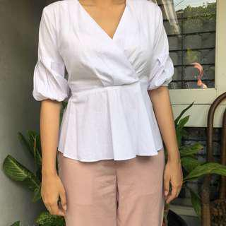 White sling blouse