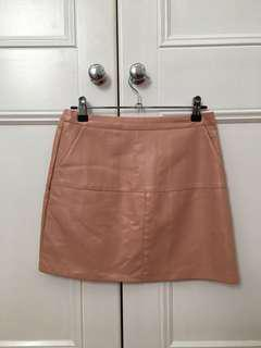 Pink faux leather mini skirt
