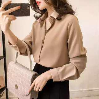 Khaki long sleeve blouse and midi length skirt