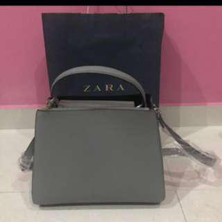 Sling and hand carry bag Zara