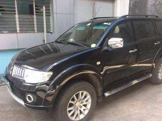 2009 Black Mitsubishi Montero Sport SUV 4X2 Car Bridgestone wheels with seat cover
