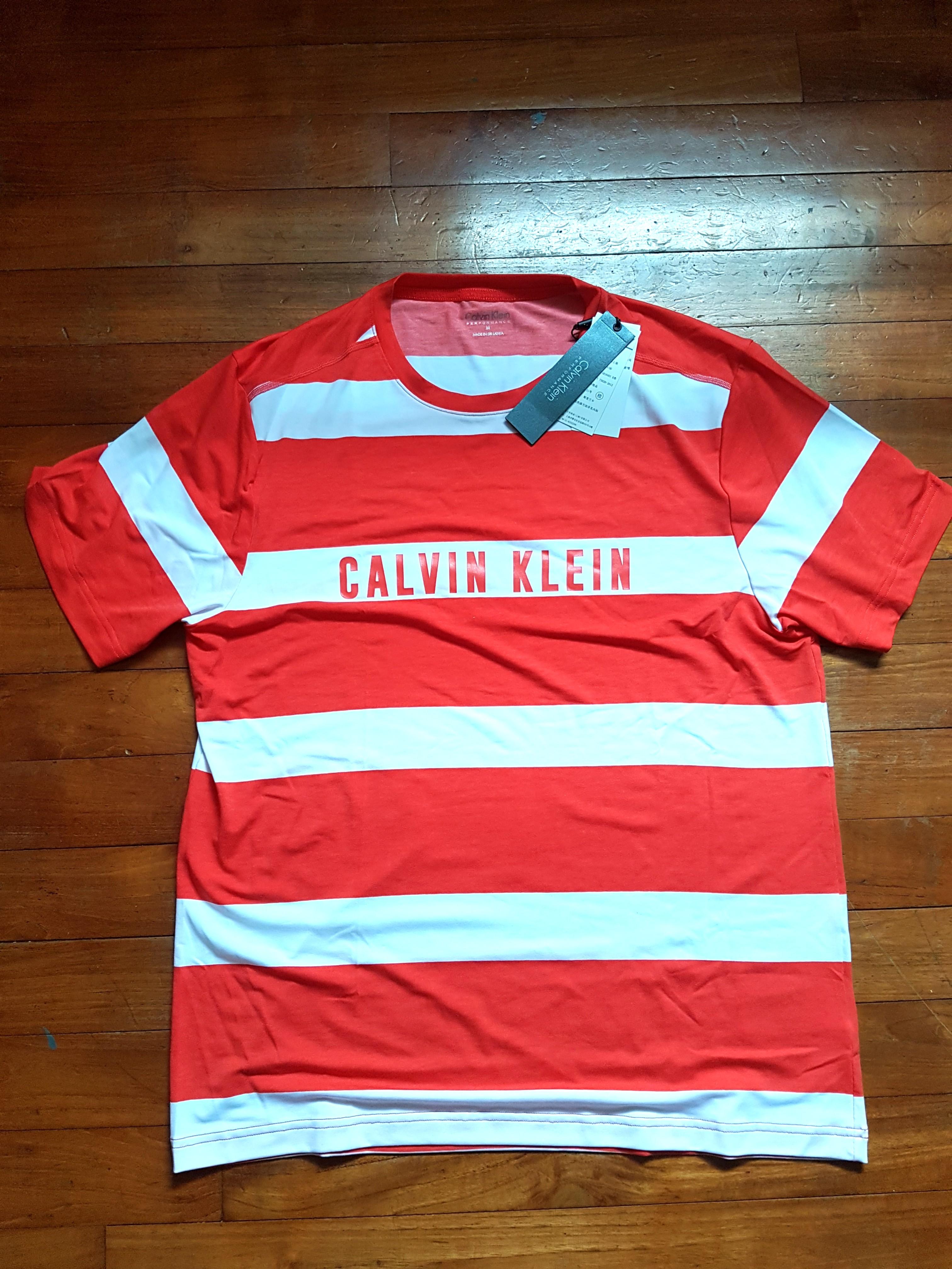 24992b8b81aa Calvin Klein Striped T-Shirt, Men's Fashion, Clothes, Tops on Carousell