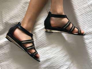 Black slightly heeled sandals with gold detailing