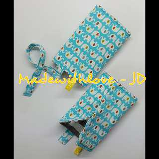 Padded drool pad with teether strap for baby carrier