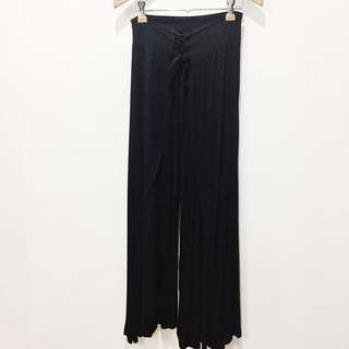 Black cotton-stretch gaucho wide leg pants w/ lace up detail