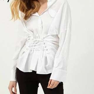 White long sleeved top with waist strap lace up