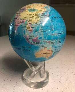 Solar powered rotating earth globe