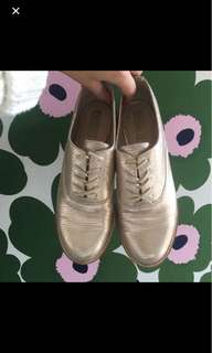 Nude gold brogues