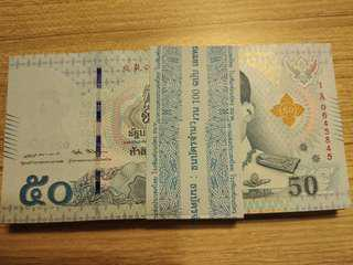 Thailand King Rama 10 50 baht banknote stack UNC