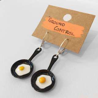 Hand-made fried egg earrings.