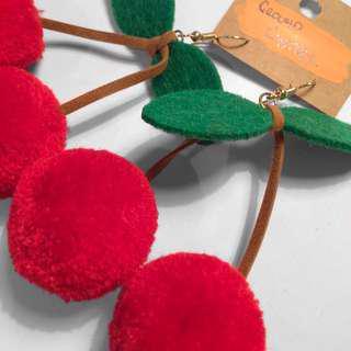 Pompon cherry earrings.