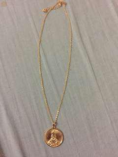 Gold pendant Santo Niño