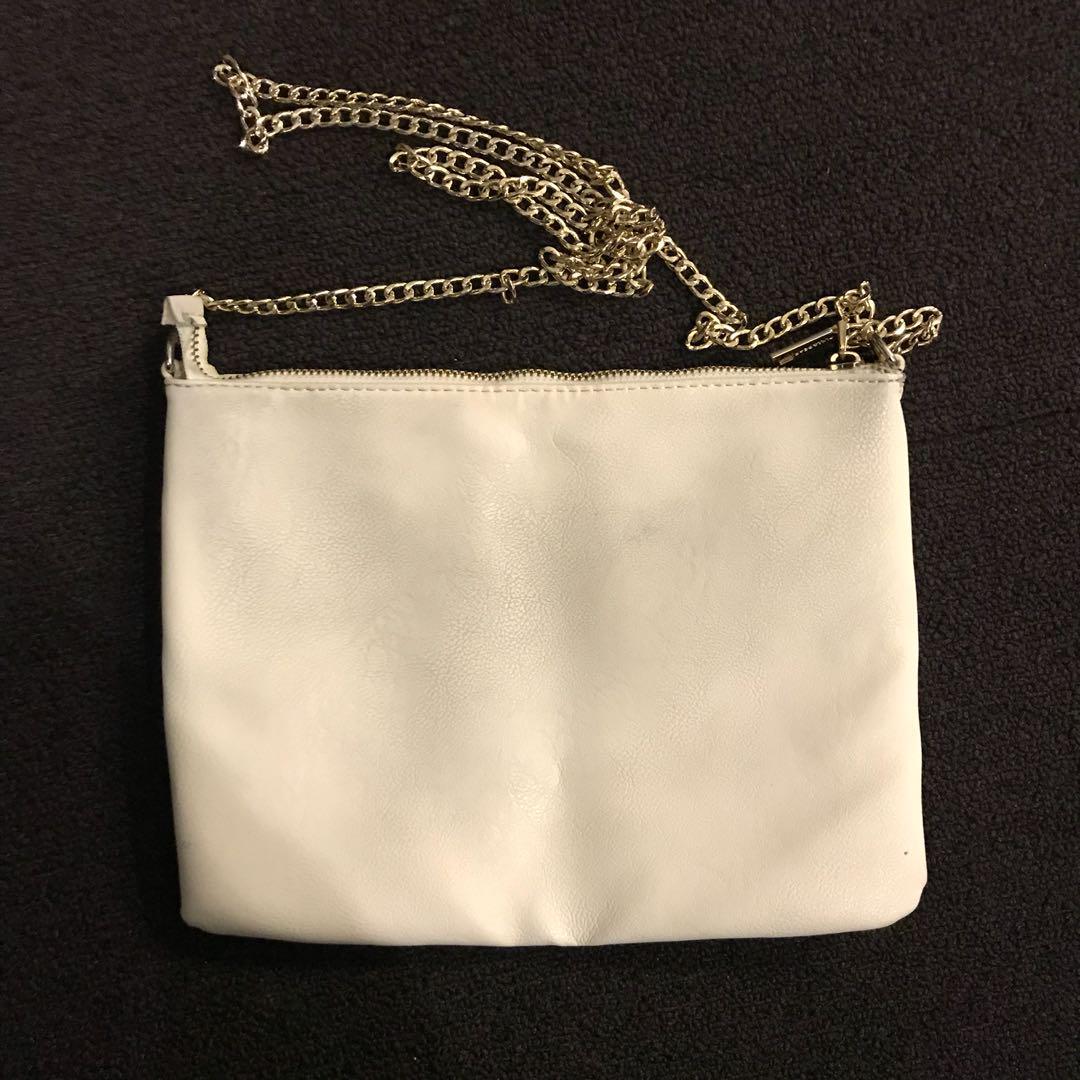 white bag, gold chain