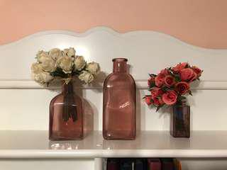 Flower vases with fake flowers