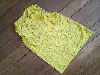 Peppermint yellow sleeveless blouse