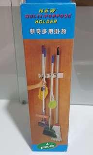 Multipurpose broom or mop holder