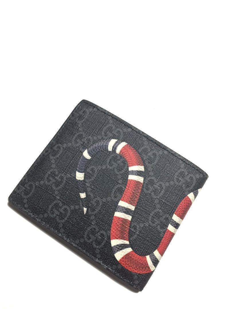 d94718e91917 Gucci snake black GG supreme wallet on Carousell
