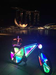 LED lights on helmets and bicycle wheel