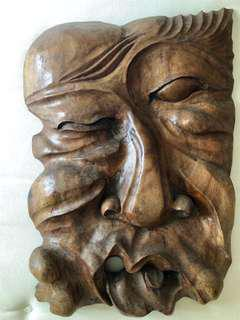 Hand-carved wooden wall hanging - mask/face