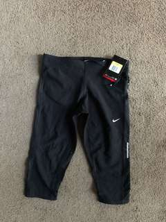 New with tags, Nike women's cropped tights, black, size small