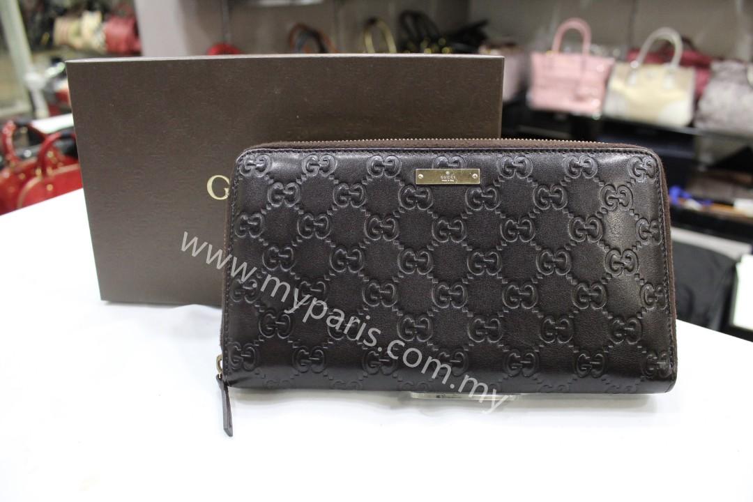 59944ab218c Gucci Dark Brown Guccissima Leather Zip Around XL Wallet