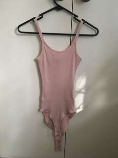 Pink ribbed body suit