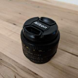 Nikon AF Nikkor 50mm lens with 50 mm NC filter