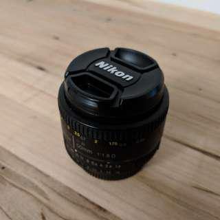 Nikon AF Nikkor 50mm lens with 50 mm NC filter