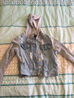 Denim jacket with grey sleeves and hoodie