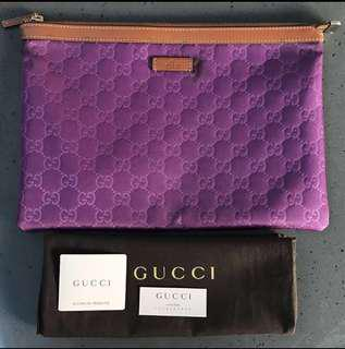 Authentic Gucci Embossed Clutch