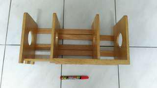 Wooden adjustable width book rack