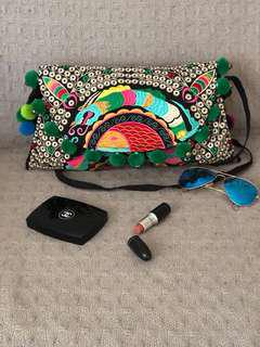 Green patchwork clutch with long strap