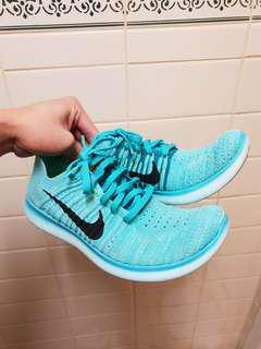 Turquoise Nike Flyknit Free