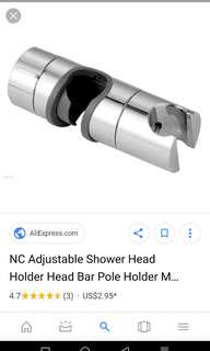 Adjustable shower head holder