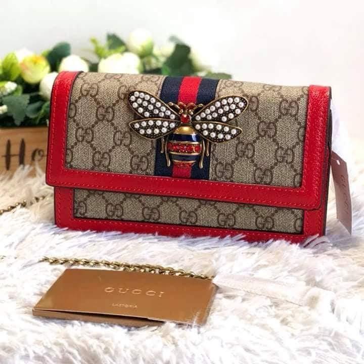 8d973fb979e Gucci Queen Margaret GG Supreme Wallet On Chain