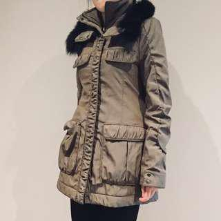 Cute brown coat with black fur