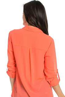 Coral coloured blouse