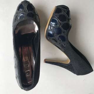 Heels branded key west disc50%