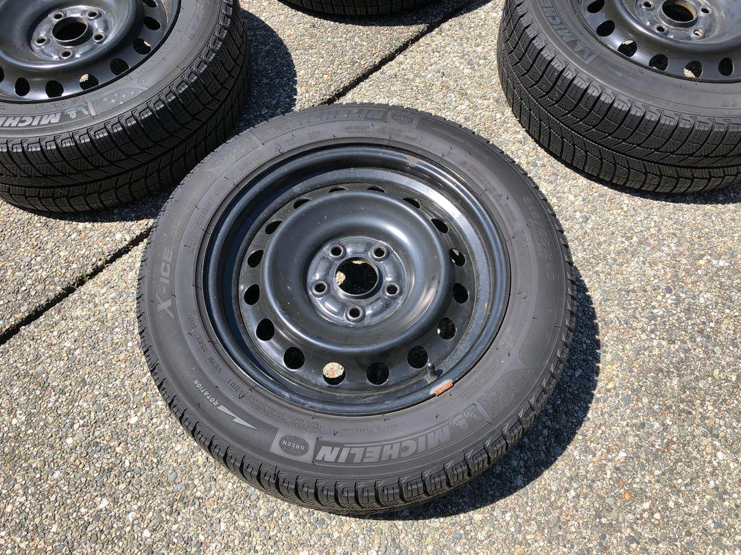 a set of MICHELIN X-ICE tires 215/55R16 with steel wheels