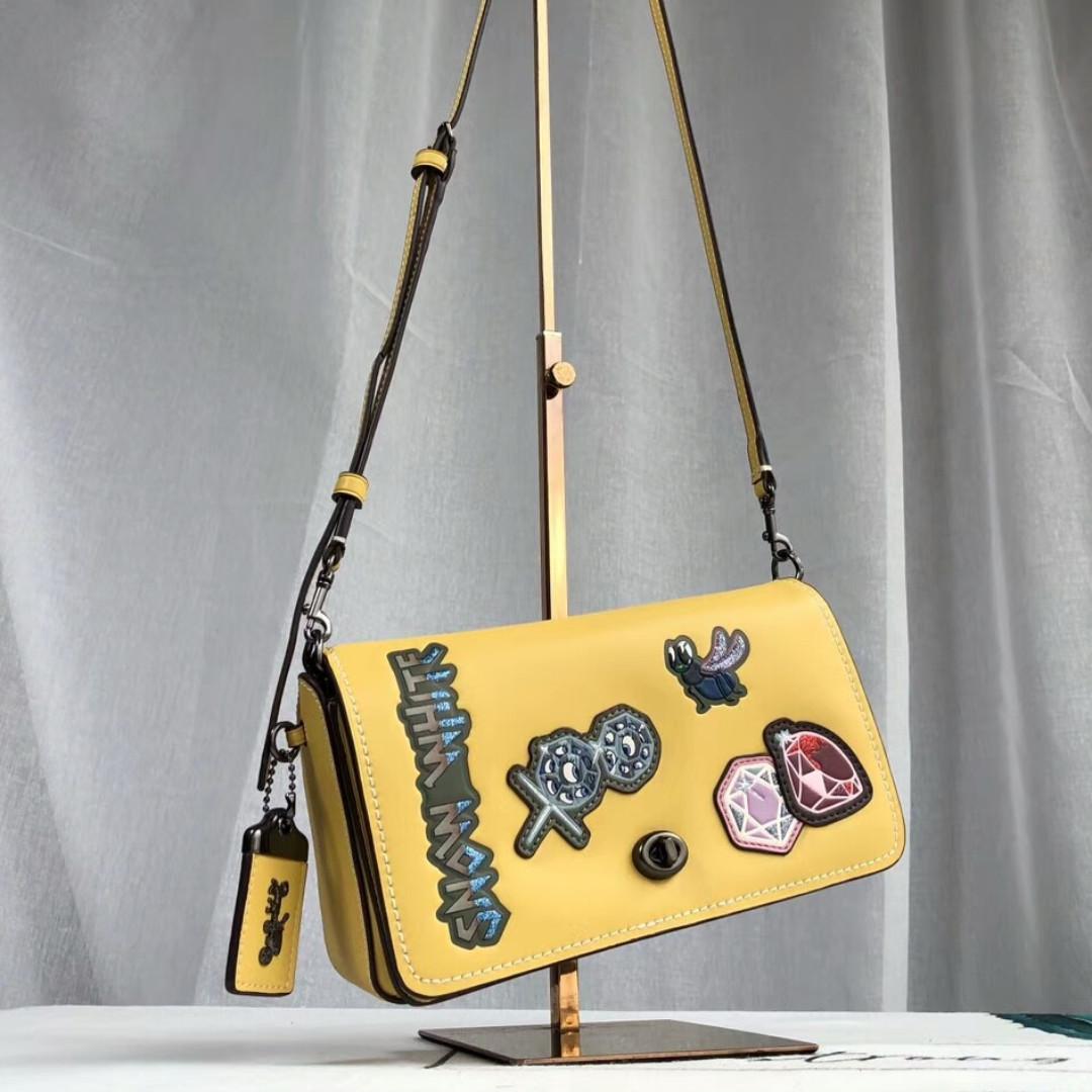 53a4083cbf68 Coach Yellow Disney Crossbody Bag