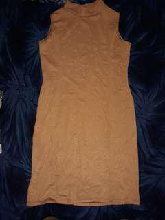 Sleeveless turtle neck dress with slit