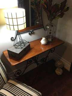 Console table with black cast iron legs and mirror. Excellent condition