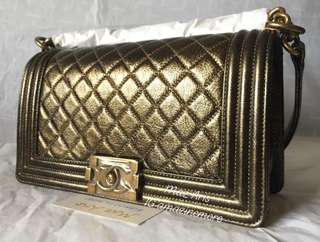 Brand new authentic Limited Edition Chanel Boy calfskin Black and gold design with aged gold hardware