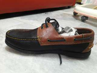 Black and brown top-sider shoes