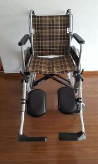 Never used wheelchair with detachable leg rests