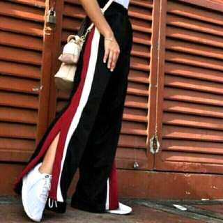 Wide track pants with slit