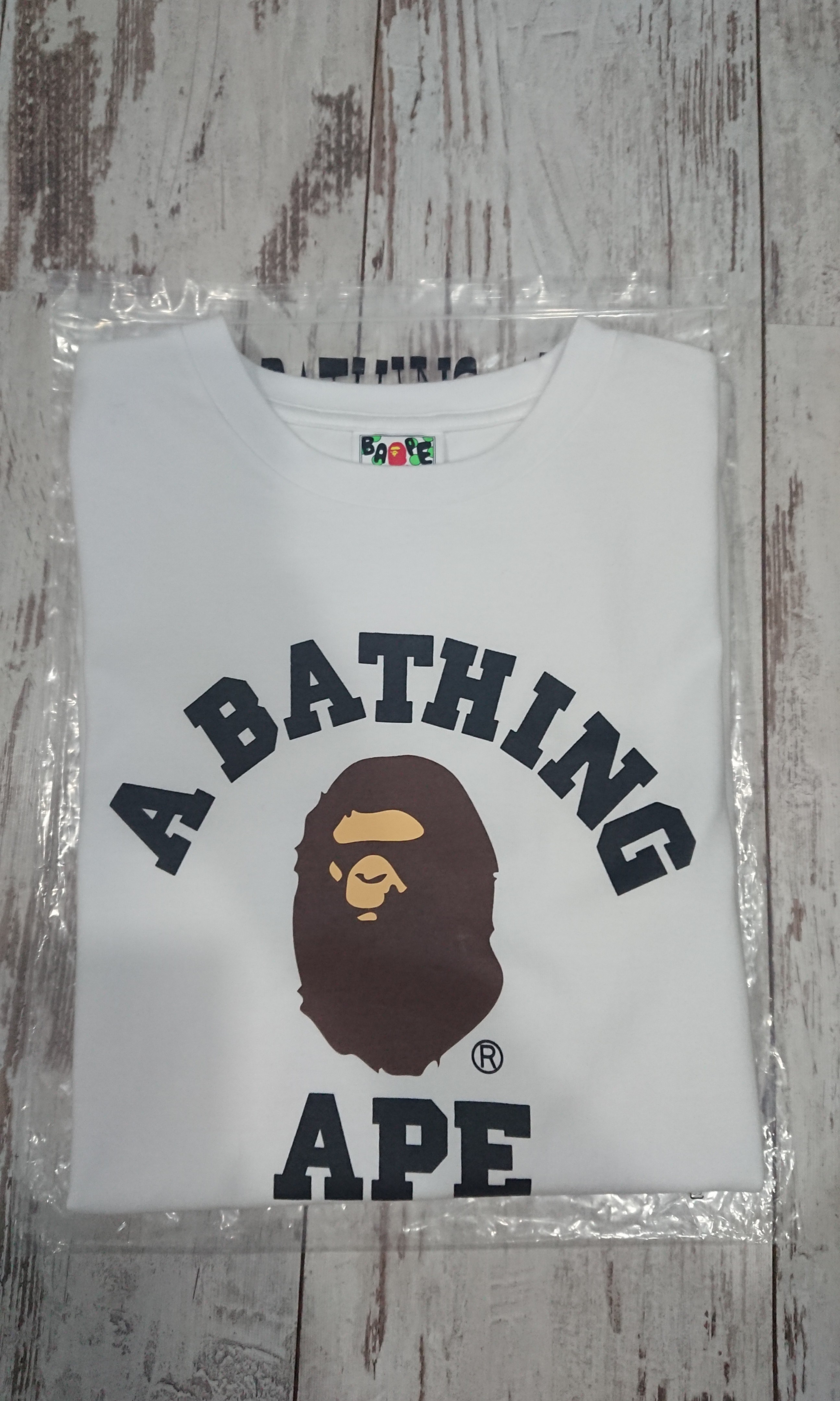 61a00ec66 BAPE COLLEGE TEE, Men's Fashion, Clothes, Tops on Carousell